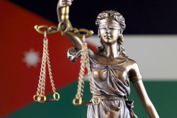 Symbol of law and justice with Jordan Flag. Close up.