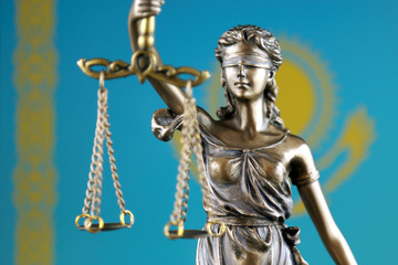 Symbol of law and justice with Kazakhstan Flag. Close up.