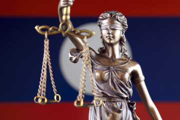 Symbol of law and justice with Laos Flag. Close up.