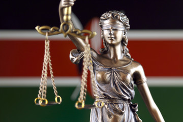 Symbol of law and justice with Kenya Flag. Close up.