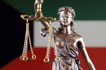Symbol of law and justice with Kuwait Flag. Close up.