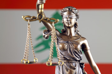 Symbol of law and justice with Lebanon Flag. Close up.