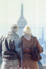 Fototapete - Romantic couple enjoying in New York City panoramic view. Manhattan downtown skyline with illuminated Empire State Building and skyscrapers seen from observation deck terrace.