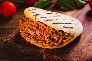 Freshly cooked Arepa with roasted meat