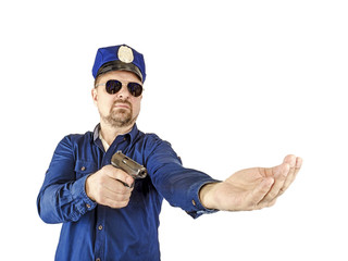 The duty policeman directs a special operation with a weapon in his hand