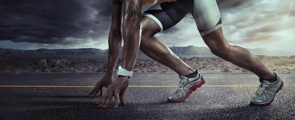 Sports background. Runner feet running on road closeup on shoe. Start line Wall mural