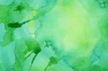 Abstract bright green watercolor splash background, painted on watercolor paper
