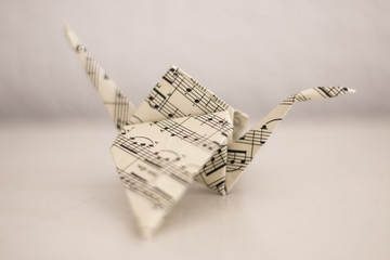 Crane folded from music paper according to the origami technique.