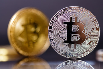 Gold and silver Bitcoin, coins virtual crypto currency on dark backgound