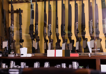 Gun shop interior with rifles