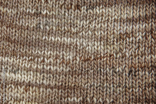 3fe4fa098f148 Wool scarf texture close up. Knitted jersey background with a relief pattern.  Braids in machine knitting