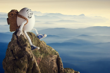 Happy funny egg hiker sitting on a cliff Wall mural