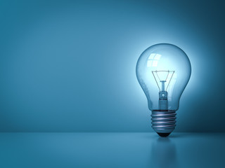 Idea light bulb glowing on the dark blue background with reflection . 3D rendering.