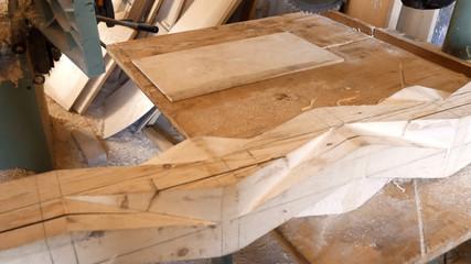 close up carpenter cutting wooden planks