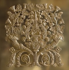 Golden decorative element in the form of a flower