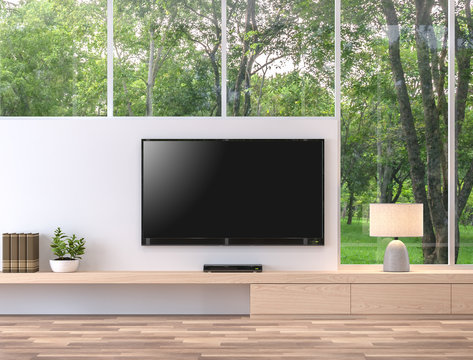 Empty television screen with nature view 3d render.There are wood floor,wood shelf and white wall. There is a clipping path to the tv screen.