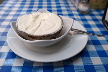 Coconut ice cream in coconut shell served with a spoon