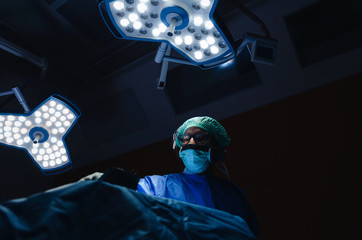 senior Doctor surgeon work for rescue patient in operation room at hospital, emergency case, surgery, medical technology, health care cancer and disease treatment concept