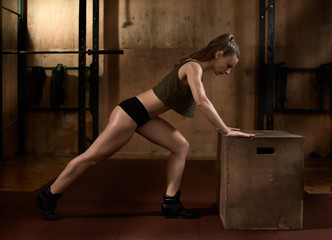 doing Plank with fit box. Athletic strong girl doing plank on box