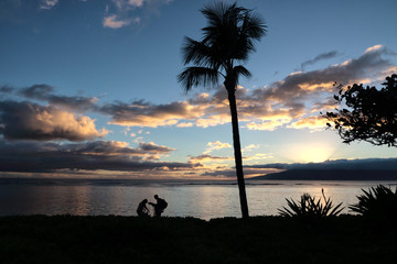 Exploring the beach at sunset on Maui.