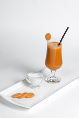 carrot smoothie on white background