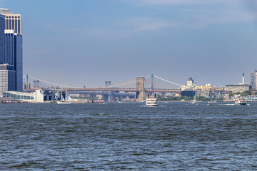 Boats sailing on Hudson River with brooklyn Bridge and Manhattan Bridge in the background, New York City, New York, USA