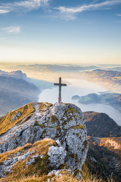 Schafberg mountain summit with cross at sunset, Salzkammergut, Austria
