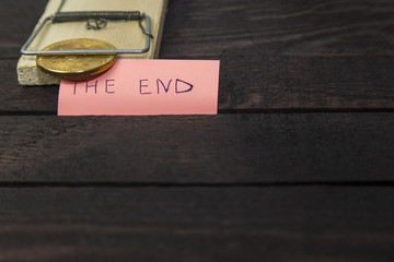 bitcoin in mouse trap and the word: THE END