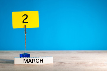 March 2nd. Day 2 of march month, calendar on little tag at blue background. Spring time. Empty space for text, mockup
