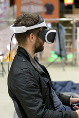 man in VR headset who enjoyng game. Virtual reality. man in VR headset with joysticks