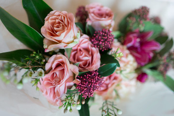 Close-up beautiful luxury bouquet of mixed flowers in glass vases. Bouquet of roses, carnations and orchids.