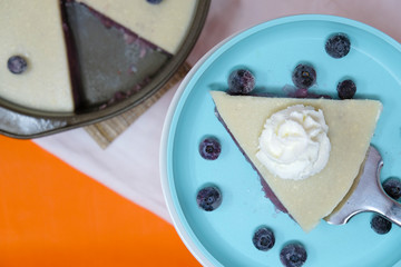 Whipped cream topped dessert recipe, shows jello like pie as food.