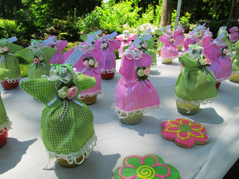 Baby Shower Favors are Dressed Beverage bottles in brilliant pink and green