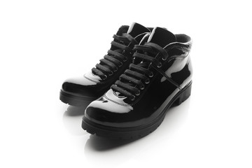 black varnished patent leather shoes isolated on white