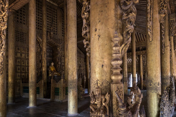 Inside the wooden Shwenandaw Monastery (also known as Golden Palace Monastery) in Mandalay, Myanmar (Burma).