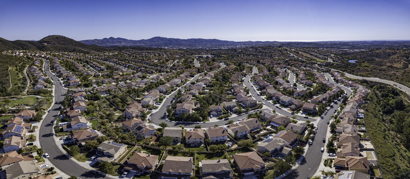 This is a 4 image aerial panoramic of Santa Fe Hills in San Marcos, California, USA. Suburban tract housing.