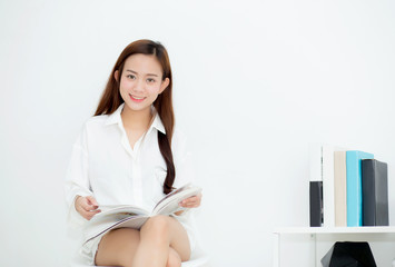 Beautiful asian young woman smile with happy reading a book, girl leisure with magazine, education concept.