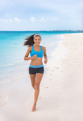 e06a1770bbea Fitness girl running on beach in fashion activewear clothes. happy ...
