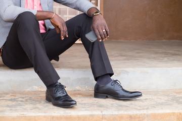 Businessman sitting holding mobile phone