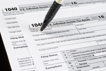 Form 1040 Individual Income Tax return form. United States Tax forms 2016/2017. American blank tax forms. Tax time.