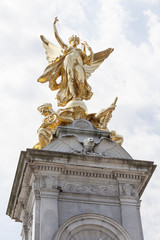 Gilded Winged Peace and Victory at the top of the Victoria Memorial in front of the Buckingham Palace, London, United Kingdom