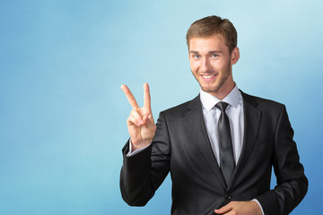 Young Businessman showing victory sign