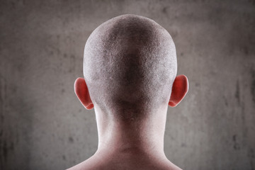 Young man with a shaved head