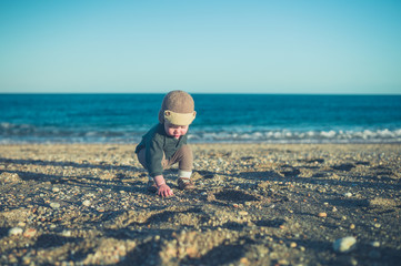 Little toddler playing on the beach