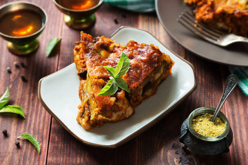 Egg-plant lasagna with cheese and tomato sauce