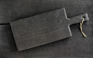 black cutting board on wooden table