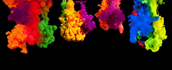 Color paint injected in water on a black background
