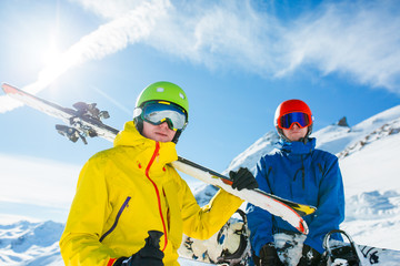 Image of sports men with skis and snowboard in winter