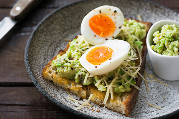 Toast with mashed avocado, egg and cheese