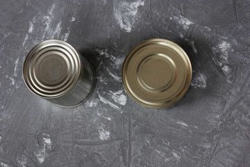 two aluminum cans on concrete background